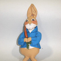 36.00 Dressed in a blue jacket, holds a carrot.